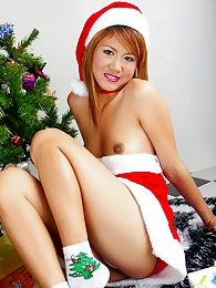 Santa's favorite little helper Jas shows her gifts pictures at freekiloclips.com