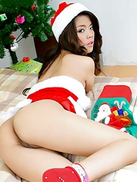 A very pretty Pang unwrapping her Xmas gift to us pictures at lingerie-mania.com
