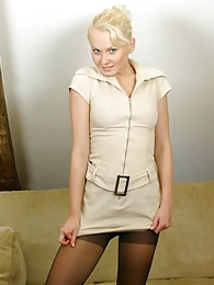 Cute blonde Karen in minidress and pantyhose pictures at adspics.com
