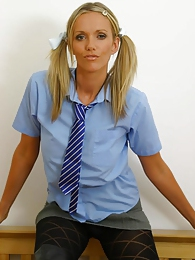Lucy Zara in college uniform with black patterned pantyhose pictures at find-best-babes.com