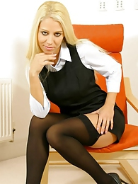 Busty blonde Morgan in secretary outfit with stockings pictures at freelingerie.us
