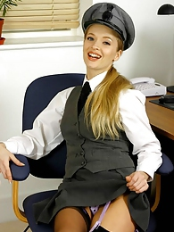 Blonde Tamara chauffeur set in stockings pictures