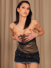 Dark haired temptress Anne does a striptease and then fingerbangs herself pictures at find-best-babes.com