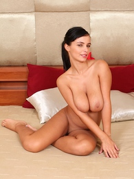 Busty babe Stella Jones spreads her shaved pussy pictures at freekilosex.com