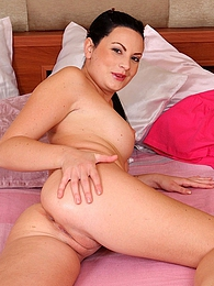 Busty babe Sybille posing naked on her bed pictures at adipics.com