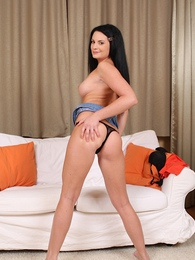 Sultry busty coed Sybille strips naked in the living room pictures at freekiloporn.com