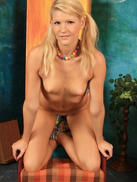 Titillating blond Nela rubs lotion all over her smooth body pictures at kilogirls.com