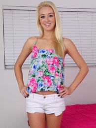 Petite blond teen Roxxi Silver spreads her pussy lips pictures at sgirls.net