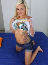 Tattooed blond coed Charli Shiin naked on her bed pictures at sgirls.net
