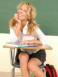 Cute schoolgirl Lita shows off her pigtails as she sits naked at her desk pictures at lingerie-mania.com