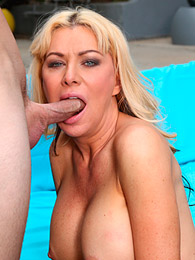 Blonde milf gives outdoor blowjob pictures