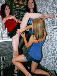 Hot clothed girls rubbing fake cocks at a crazy sex party pictures at sgirls.net
