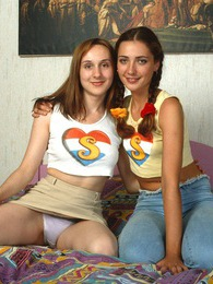 A hot teenage beauty sitting on a giant lesbian strapon pictures at kilosex.com