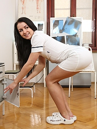 Brunette teen nurse fucking her snatch with dildo at work pictures at lingerie-mania.com