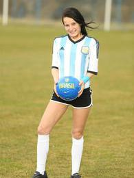 She is in the football stadium and wants to play but what? pictures at adipics.com