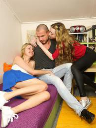 Two sexy blonde teen sirens share a large cock in threesome pictures