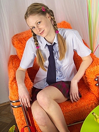 Veronika is a cute but very naughty teen girl playing for us pictures at lingerie-mania.com