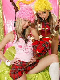 Two lesbian teen girls blowing on their scottish bagpipes pictures
