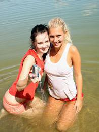 Two young girls on the beach start with licking and then.. pictures at adipics.com