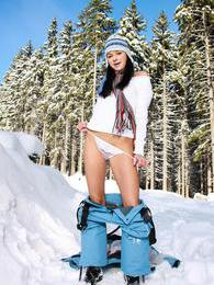 Naughty teen Ella in the snow opening her legs for a sex toy pictures
