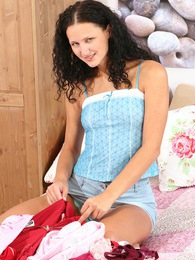 Curly haired Anneloes fingering her own amazing little twat pictures at lingerie-mania.com