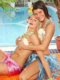 Tropical Lesbians Debbie and Mia have lesbian sex poolside pictures