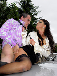 Fully clothed daring babe shagging horny chap on his car pictures at lingerie-mania.com