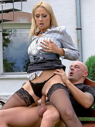 Bald dude enjoys banging a gorgeous clothed beauty hard pictures