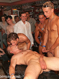 Wild and crazy gay men in an oiled up groupsex orgy party pictures