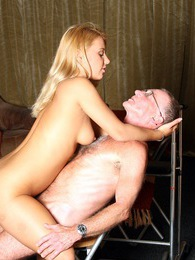 Horny grandpa releases his big boner on a blonde hottie pictures at freekilosex.com
