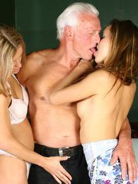 Horny grey senior enjoys two sweet babes their pussies pictures at adspics.com