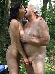Horny grey senior fucking a brunette beauty in her pussy pictures at freekiloporn.com