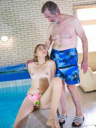 An older guy is laying by the pool but gets a hot surprise! pictures at kilovideos.com