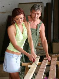 Brunette babe riding older man his stiff schlong at work pictures at freekiloclips.com
