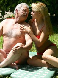 Busty blonde beauty fucked outdoor by a senior zen master pictures
