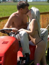 An old guy on a lawnmower fucks a hot bikini babe outdoors pictures at freekilopics.com