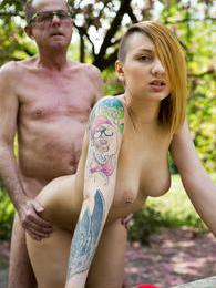 Tattooed busty young Christie fucking a senior outdoors pictures