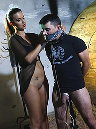 Brunette mistress Katie giving a forced handjob to her slave pictures at kilogirls.com