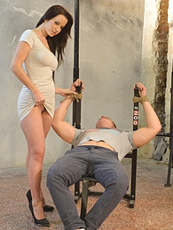 Bound man is wanked by gorgeous femdoom brunette and cums pictures