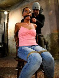 Bound to a chair she gets her big tits grabbed and slapped pictures at find-best-mature.com