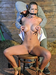 Busty slave Nicole Vice gets chair-tied and tit-grabbed pictures at freekilomovies.com