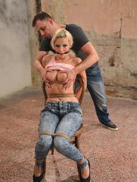 Big breasted blonde slave Karol gets chair tied and punished pictures at adspics.com