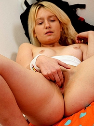 Cute naked schoolgirl masturbates with her moist fingers pictures