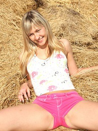 Cute teenage girl masturbating outside in a pile of hay pictures at kilogirls.com