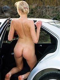 Car loving hottie pleasures her tight wet pussy outdoors pictures at freekilosex.com