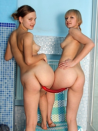 Two teenage lesbian beauties sharing a super long dildo pictures at lingerie-mania.com