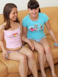 Horny teen chicks petting each others snatch on a couch pictures at sgirls.net