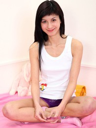 Smiling horny sweetheart strokes her tight teenage cooter pictures at kilogirls.com