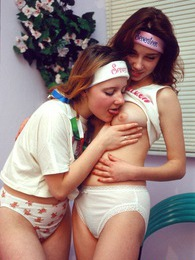 Two adorable teenage lesbians enjoy undressing each other pictures at lingerie-mania.com