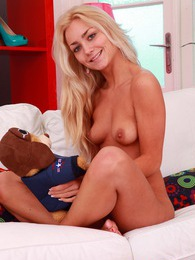 Horny teenage blonde undressing her body for the camera pictures